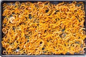 Baked Sweet Potato Noodles on a baking sheet