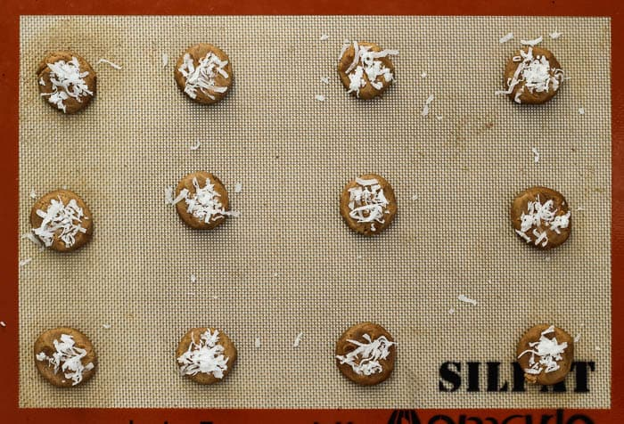 Cookie Dough with Coconut Shreds Before Baking on a baking sheet with a silpat mat