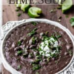 A bowl of black bean and lime soup with text overlay