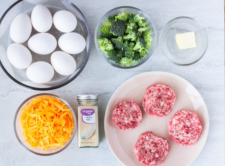 Ingredients needed to make a sausage scramble on a white background