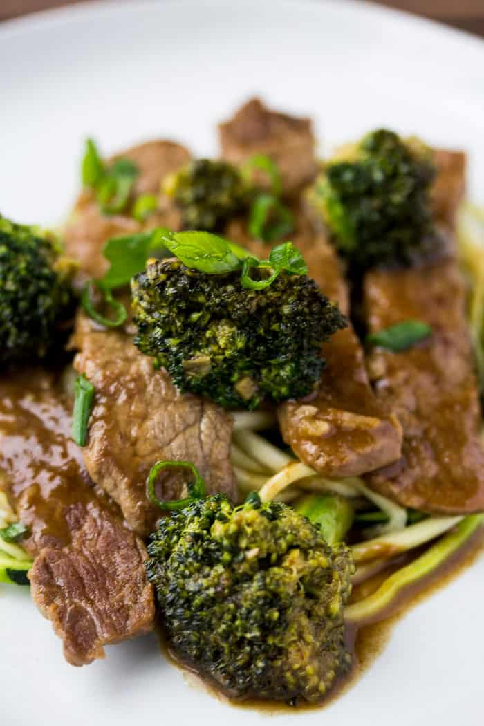 Close up of beef and Broccoli Zoodles on a white plate