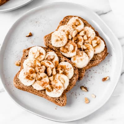 2 slices of banana toast with cinnamon, brown sugar and walnuts