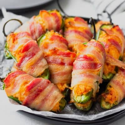 Close up of buffalo chicken jalapeno poppers on a black plate
