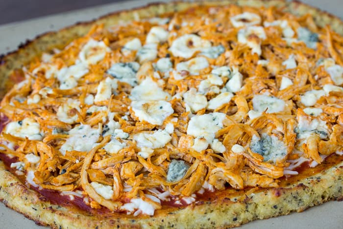 Baked Keto Buffalo Chicken Pizza on a Pizza Stone