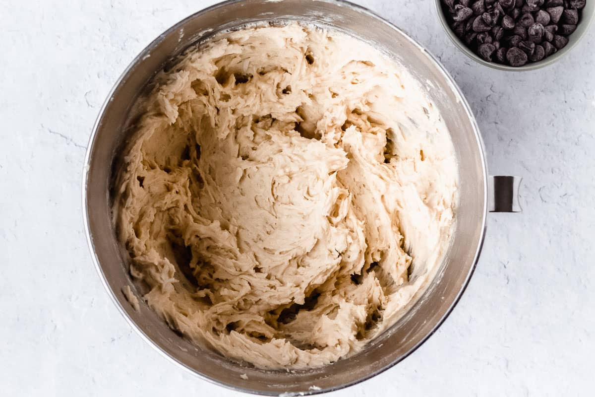 Cookie dough in a silver mixing bowl