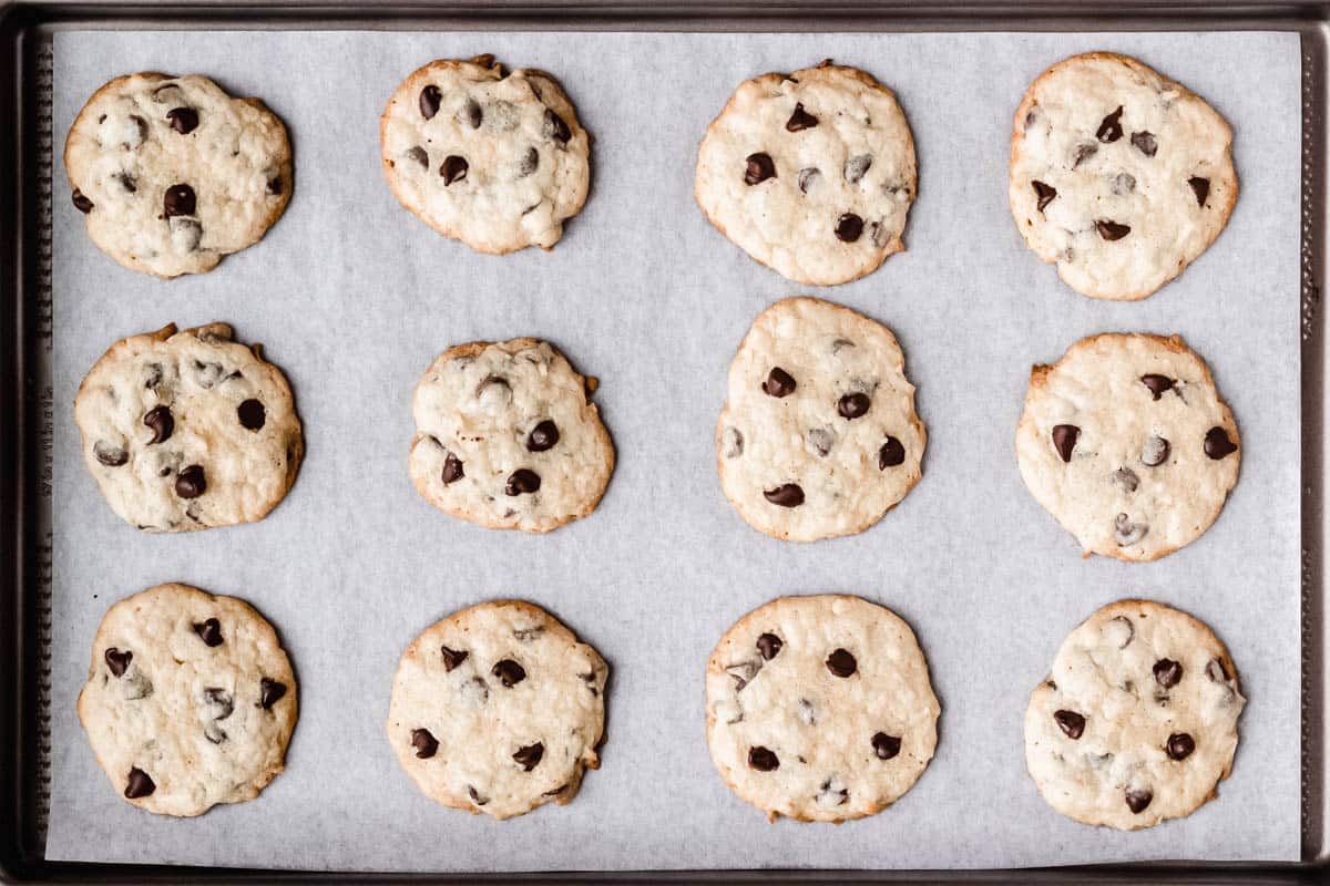 Baked coconut chocolate chip cookies on a baking sheet