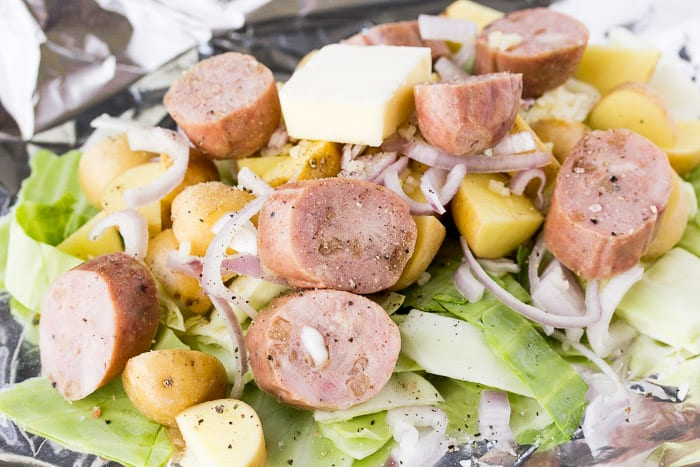 raw cabbage, sausage, potatoes and shallots in a Foil Packet Prior to Cooking