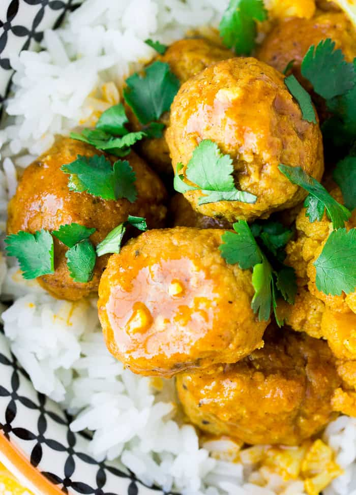 Close up of a bowl of Coconut Curry Meatballs Over Rice