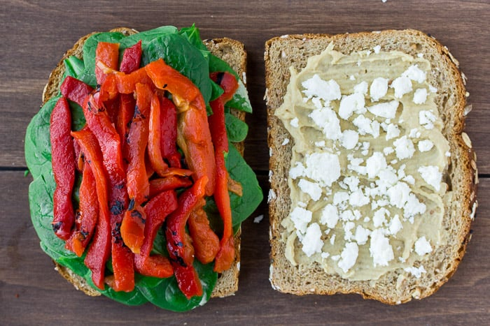 Spinach, Roasted Red Peppers, and Feta Added to the Bread Slices