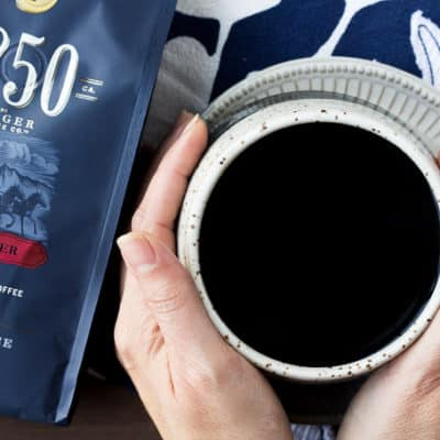 A Package of 1850 Coffee and a Cup of Coffee on a Blue Napkin