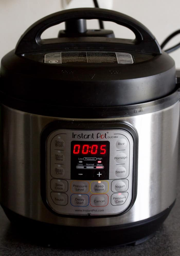 Instant Pot Set to 5 Minutes on a kitchen counter