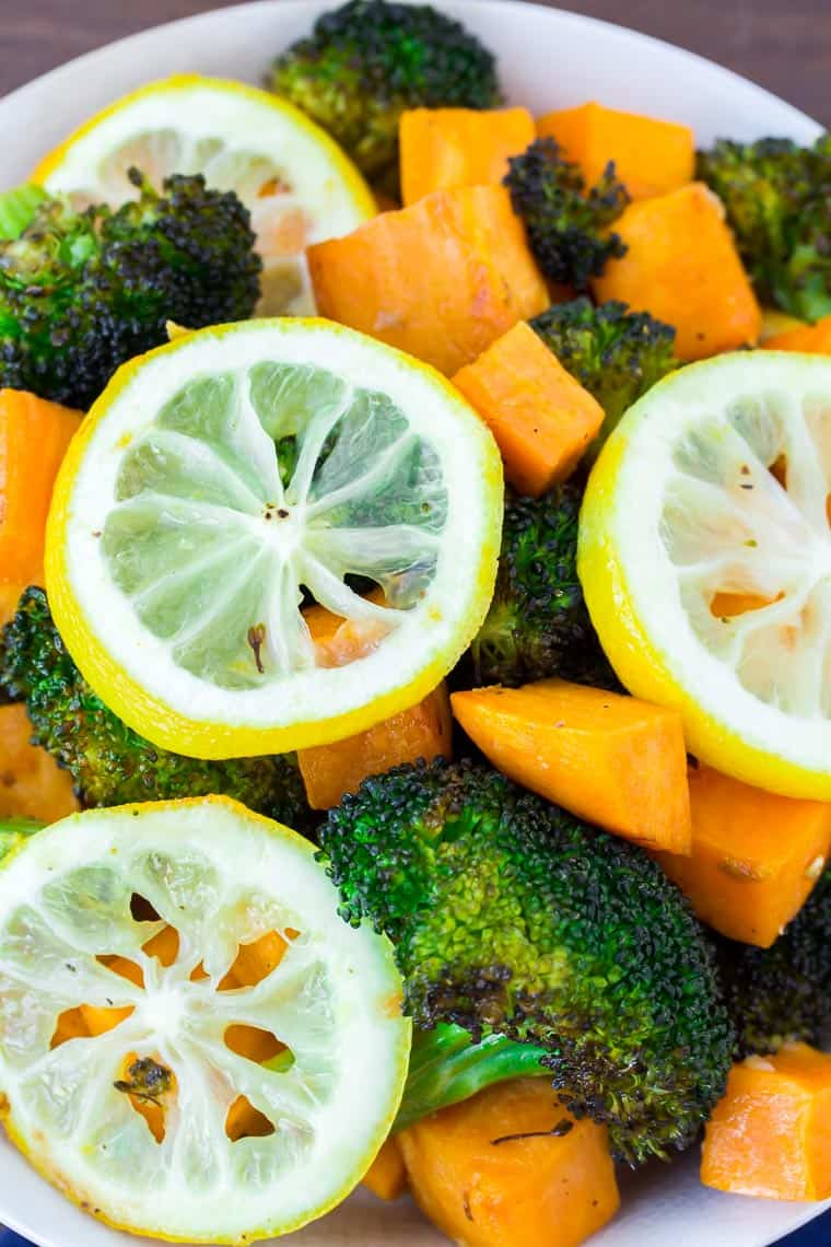 Lemon Roasted Broccoli and Sweet Potatoes with Lemon Slices Close Up