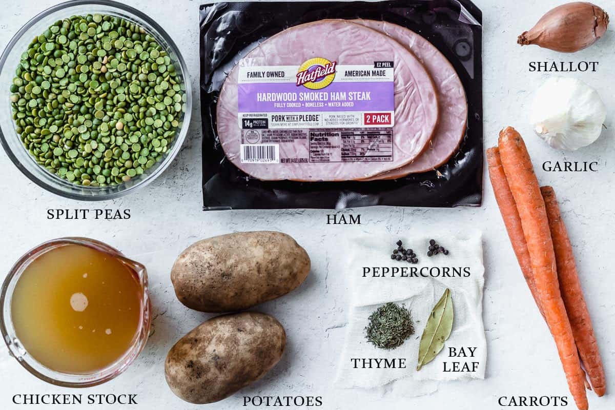 Ingredients to make split pea ham soup on a white background with labels