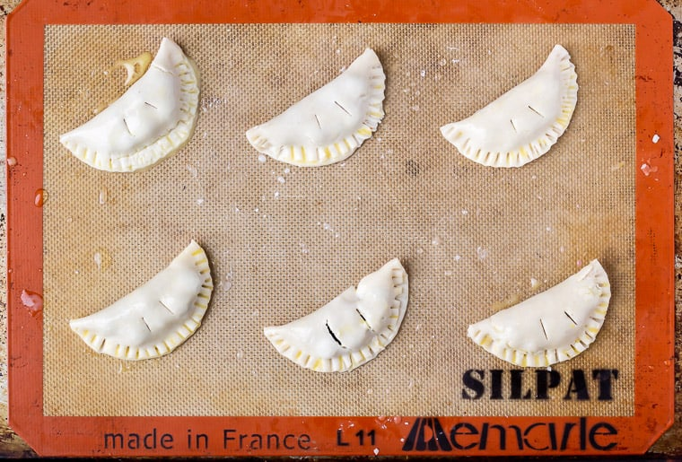 6 Sealed mini hand pies on a silpat mat