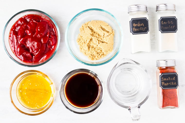 Ingredients to make honey barbecue sauce on a white background