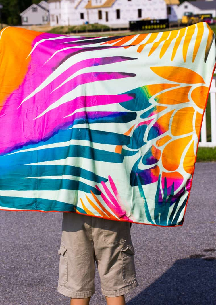 SUmmer & Rose Palms Design Beach Towel Held Up to Show Design