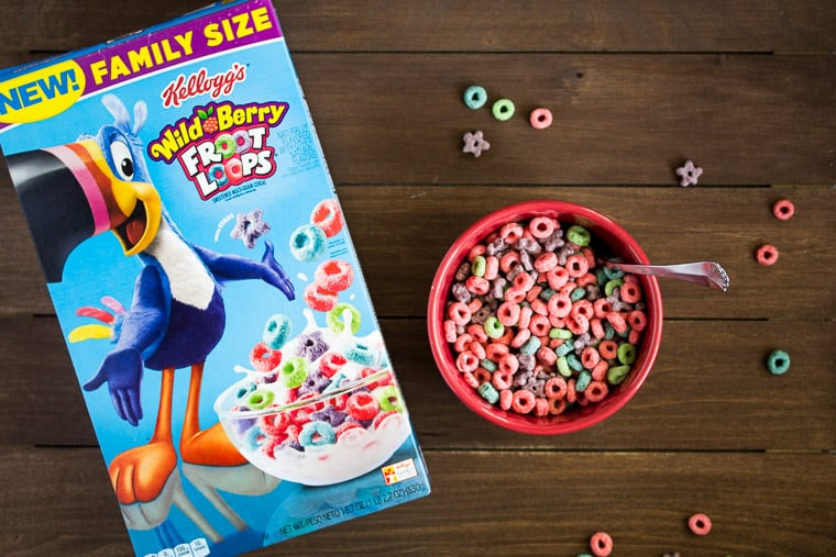 Wild Berry Froot Loops on a Wood Table (box and bowl full with extra cereal around)