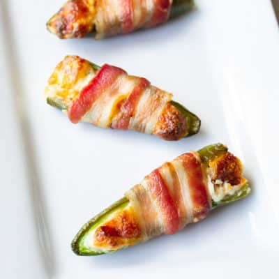 Extreme bacon jalapeno poppers on a white tray