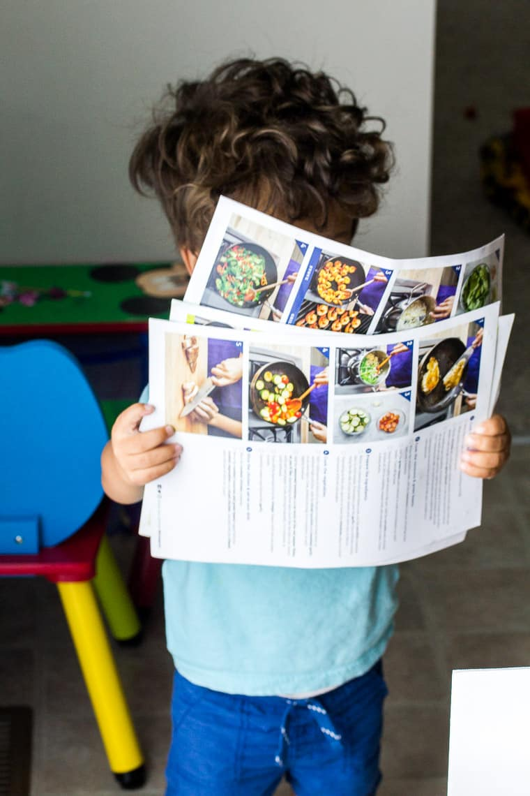 Little Boy Looking at the Blue Apron Recipe Cards