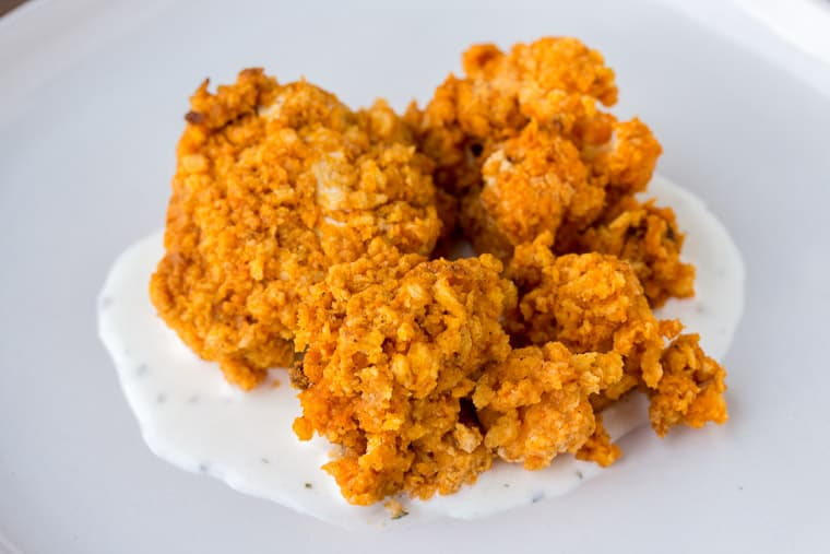 Buffalo Bites on Ranch Dressing on a White Plate