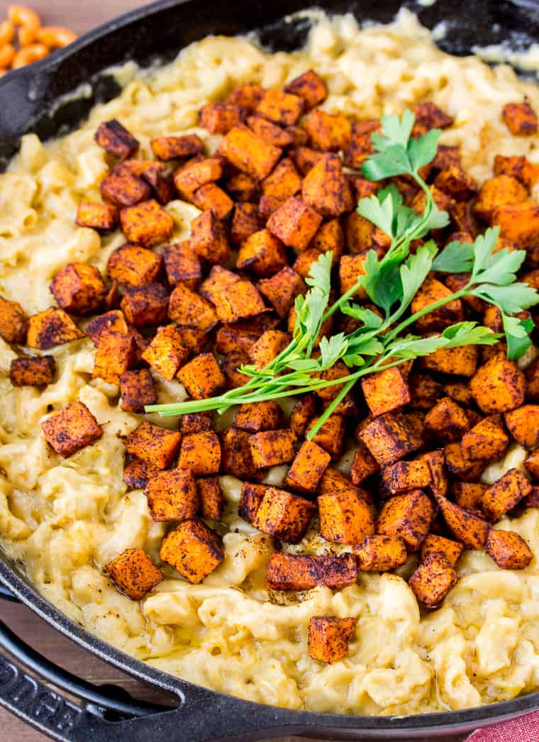 Chili Sweet Potato Mac and Cheese in a Cast Iron Skillet Close Up at an Angle