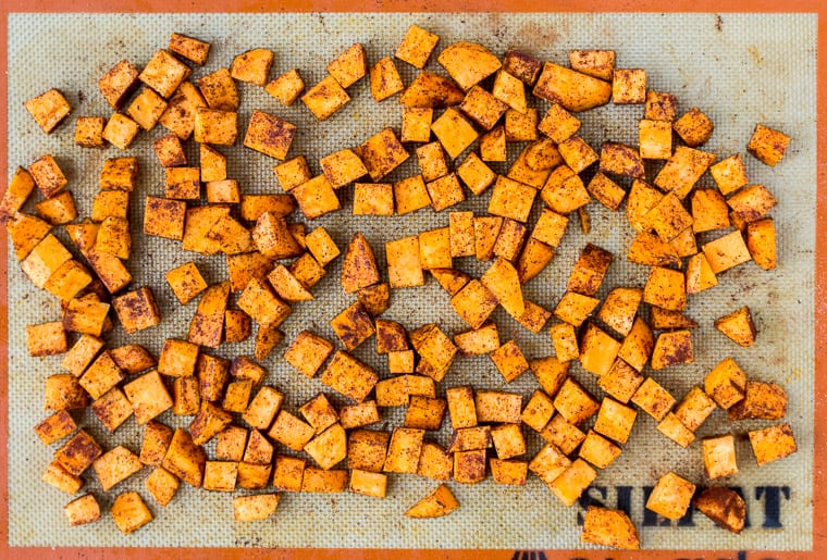 Sweet Potatoes on a Silpat Lined Baking Sheet Before Baking