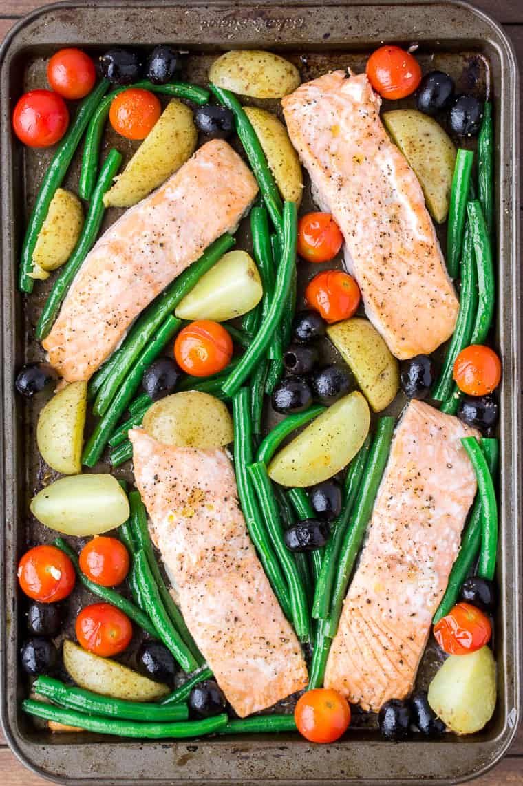 Baked Salmon and Vegetables Mixed Together on a Sheet Pan