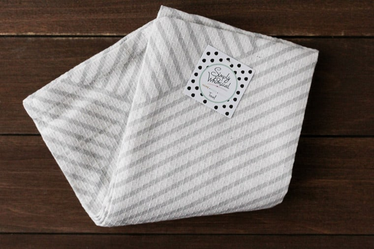 Gray and White Tea Towels on a Wood Backdrop