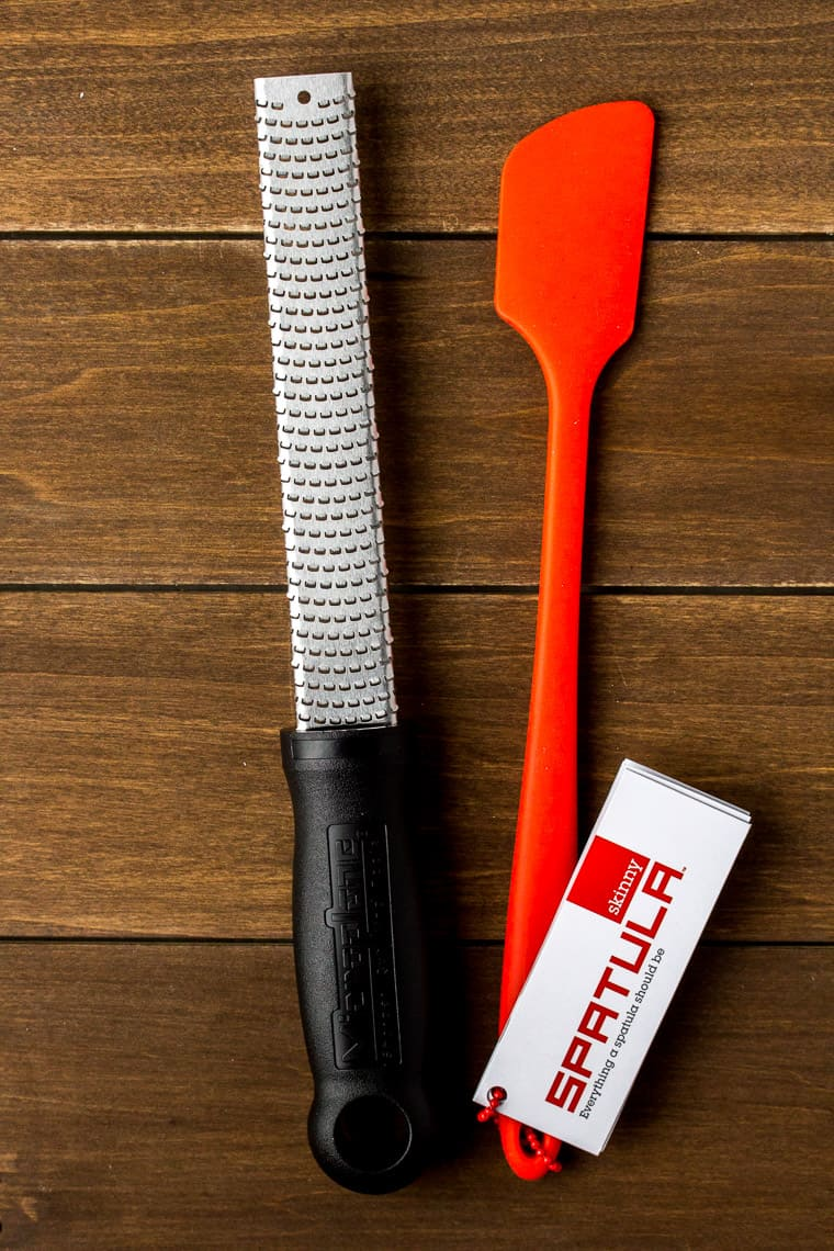 Gir Skinny Spatula and Microplane Zester on a Wood Backdrop
