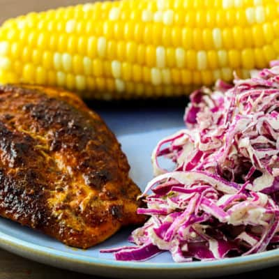 Blue Apron Spicy Chicken and Honey Butter Corn on a Blue Plate with Coleslaw