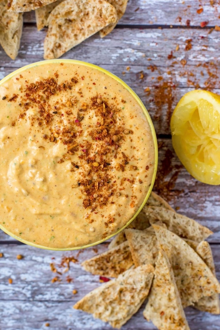 Butternut Squash Hummus in a Yellow Bowl with Gray Wood Backdrop