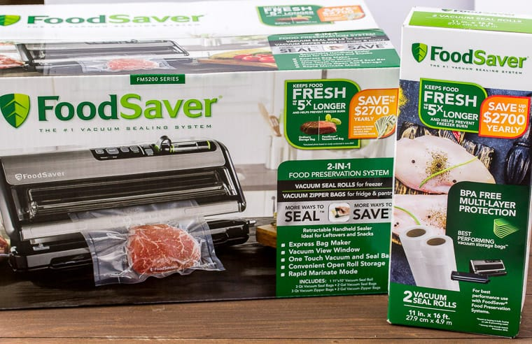 FoodSaver Sealing System and Bag Refill Packaging on a Wood Backdrop