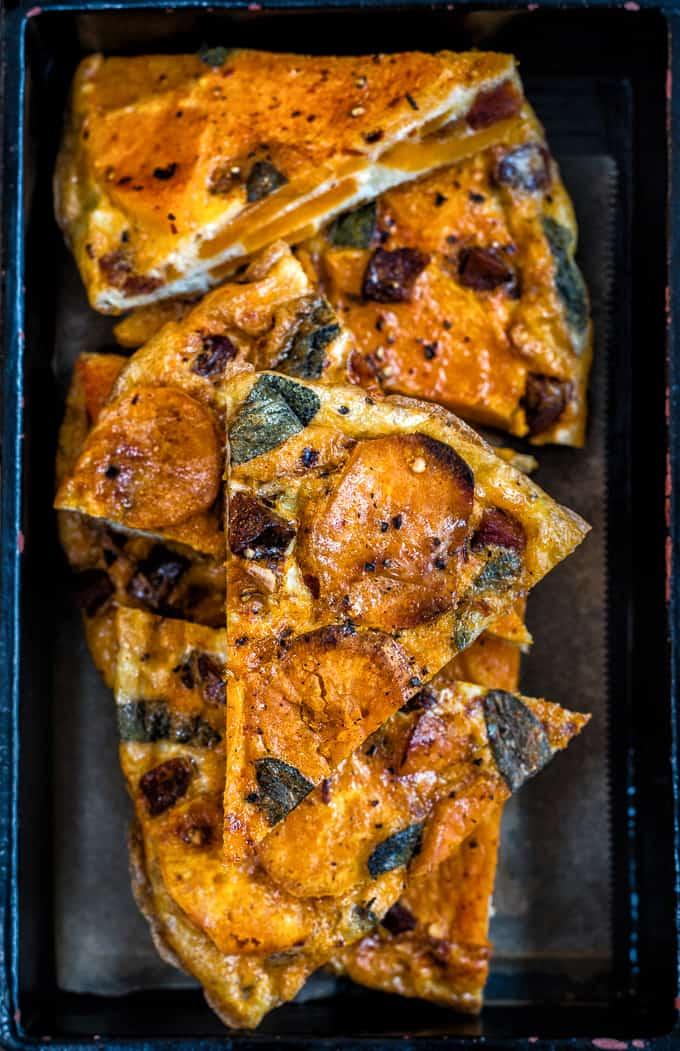 Spanish Butternut Squash Tortilla Cut in Triangles with Dark Background