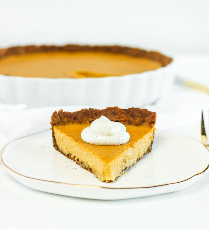 Butternut Squash Tart Slice on White Plate with White Backdrop