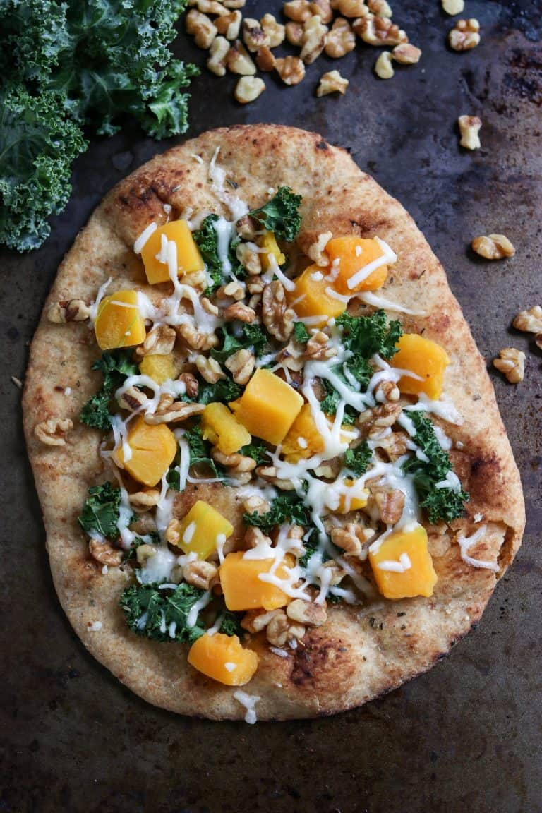 Butternut Naan Pizza on a Dark Backdrop