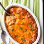 Overhead of barbecue chicken dip with a spoon it in and text overlay