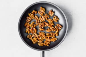 Maple walnut in a small skillet on a white background