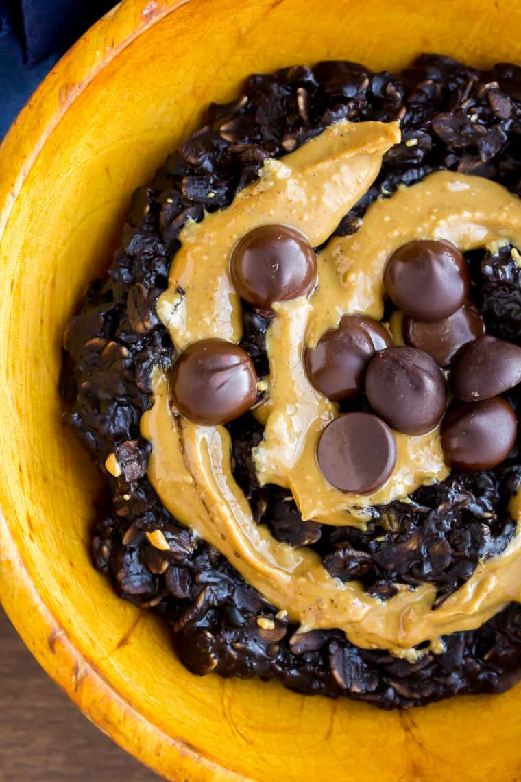 Dark Chocolate Peanut Butter Oatmeal with Dark Chocolate Chips in an Orange Wood Bowl