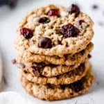 Stack of 5 oatmeal cranberry chocolate chip cookies on a white background
