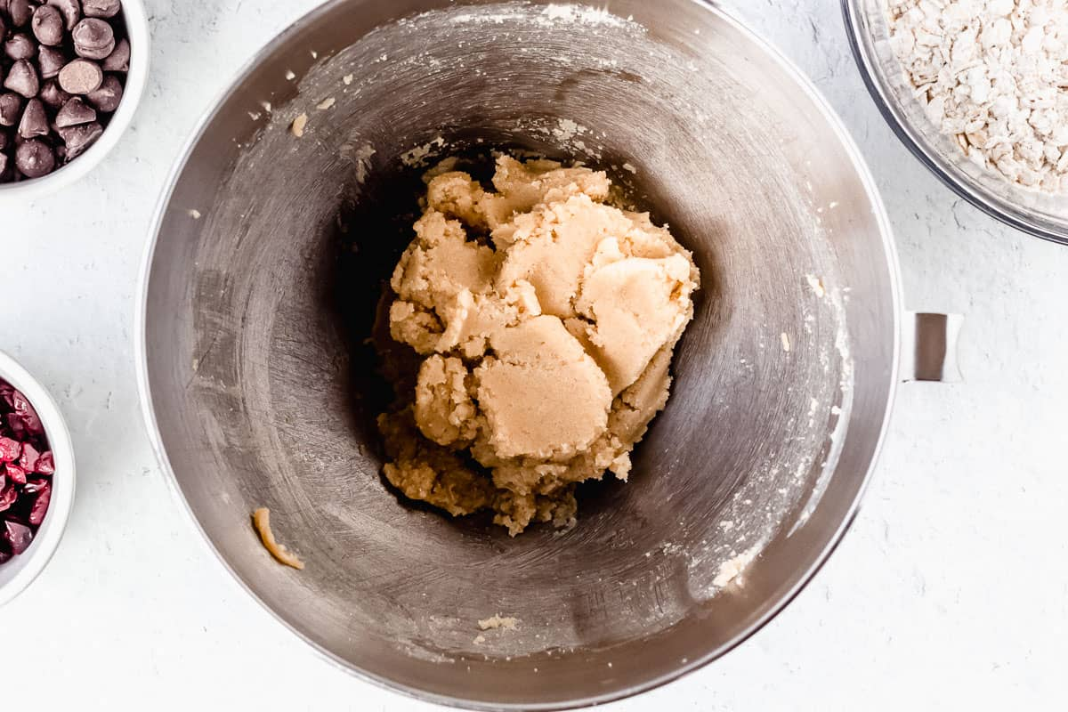 Butter and sugars creamed together in a silver mixing bowl