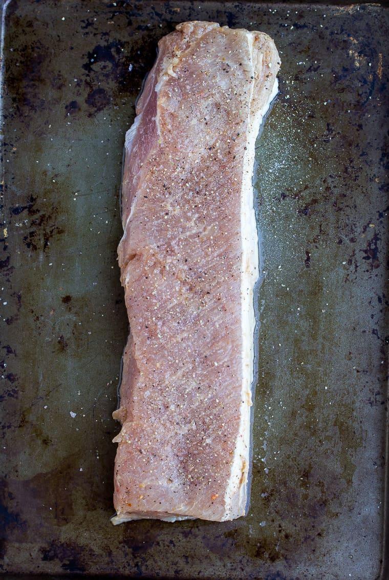 Seasoned Pork Tenderloin on a Baking Sheet
