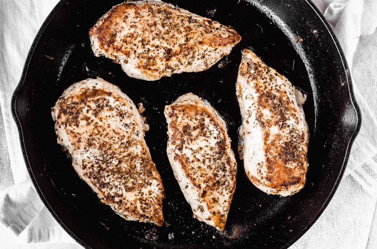 Chicken browned in a cast iron skillet