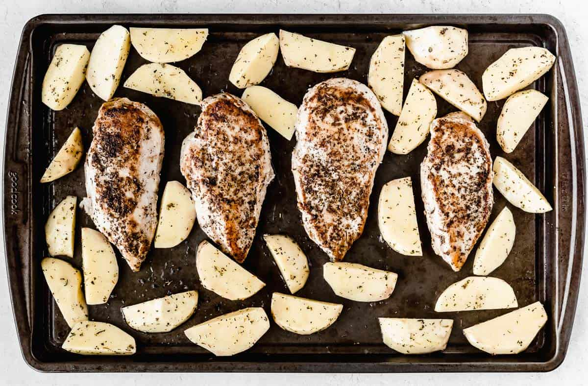 Browned chicken and potatoes on a sheet pan