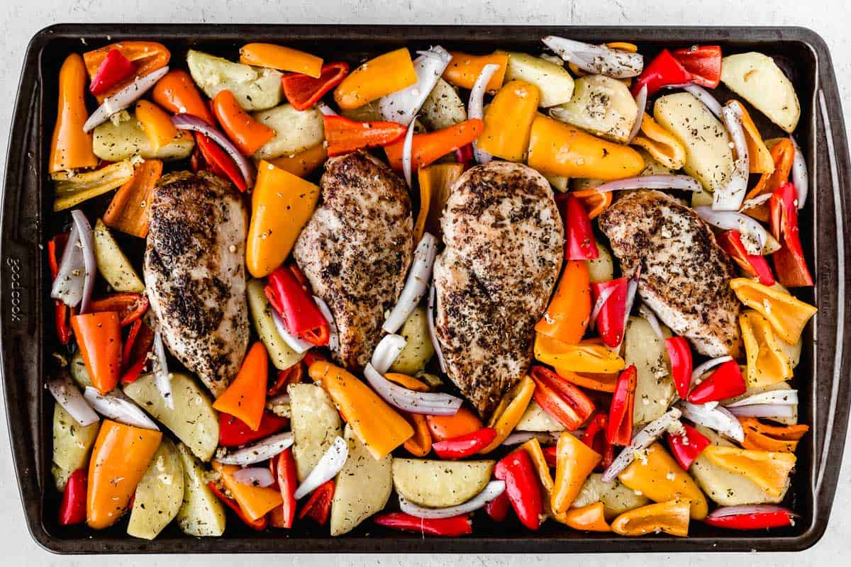 Chicken, potatoes, and peppers on a sheet pan