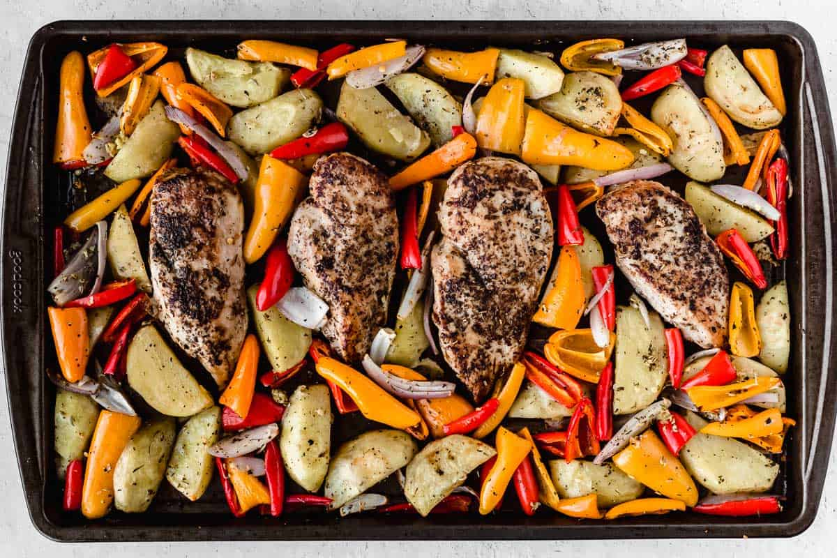 Roasted chicken, potatoes, and peppers on a sheet pan