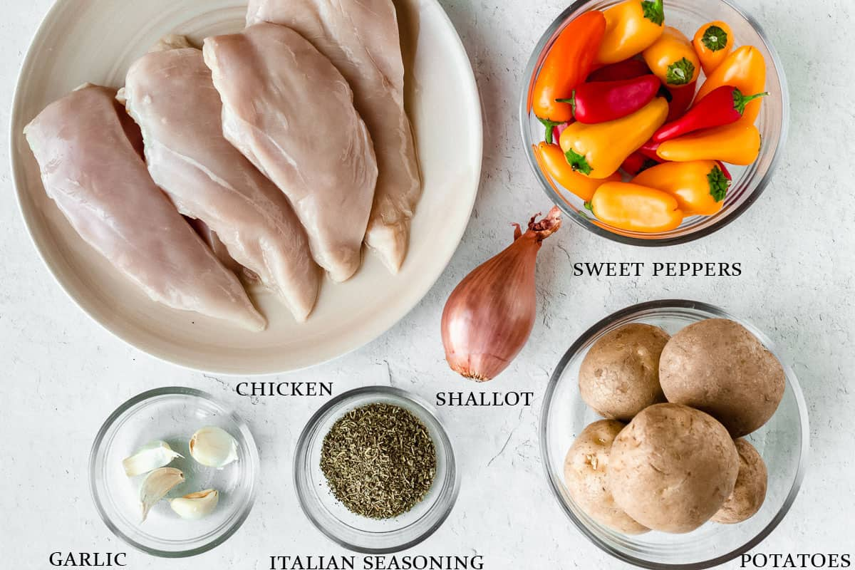 Ingredients for sheet pan italian chicken on a white background with labels