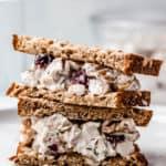 Cranberry walnut chicken salad sandwich with text overlay