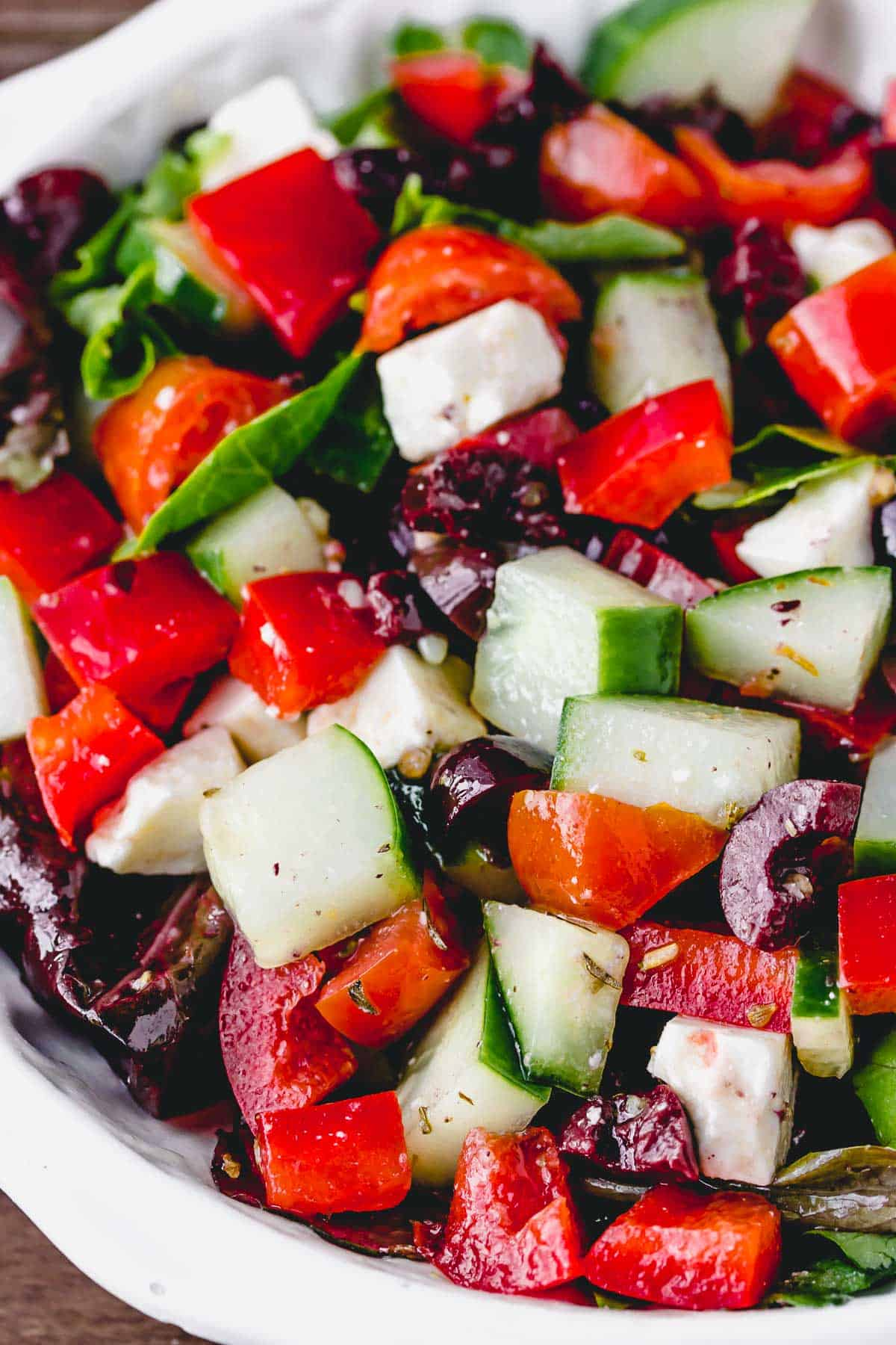 Keto Greek Salad mixed together in a white bowl