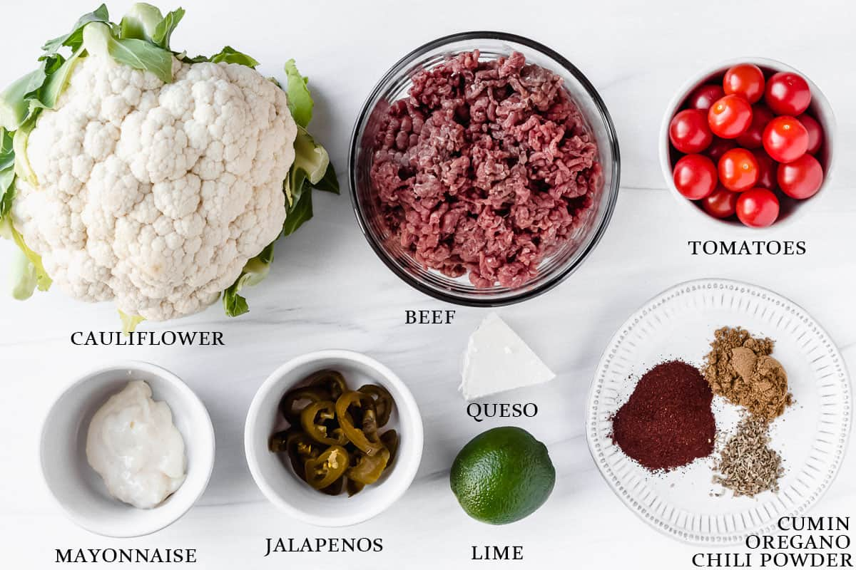 Ingredients for keto mexican beef bowls with labels on a white background