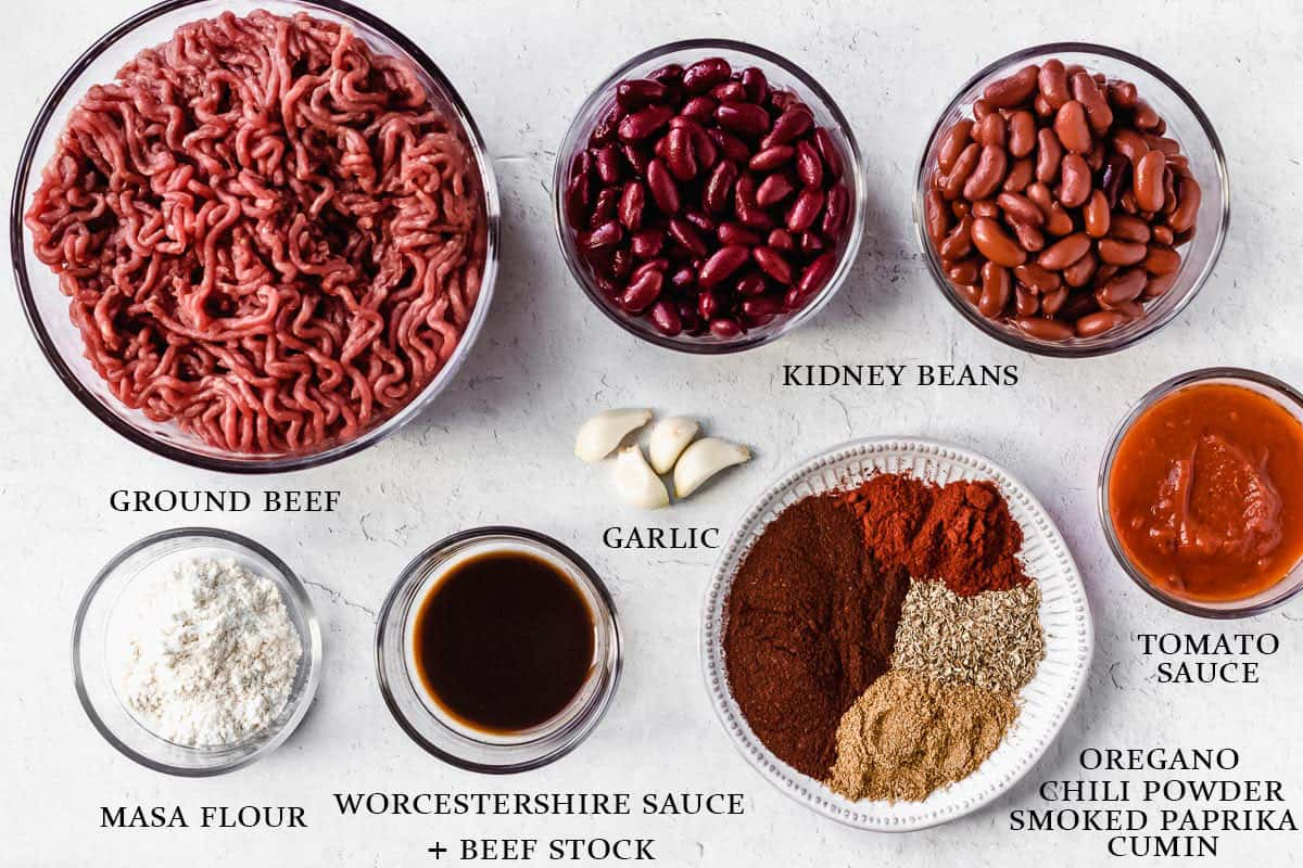 Ingredients for smoky beef chili on a white background with labels